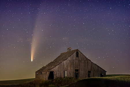 Barn in front of night sky