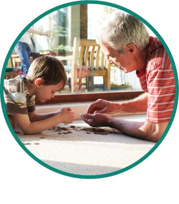 Grandson and grandfather counting change