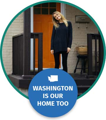 A woman in her 30s stands and smiles on the front porch of her new home. Text below reads Washington is our home too.