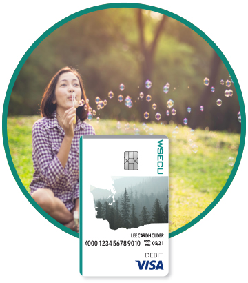 Girl blowing bubbles and WSECU Debit Card