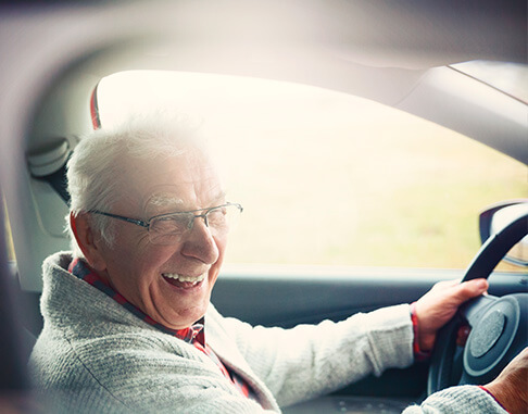man driving a car smiling