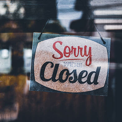 Closed sign on store window